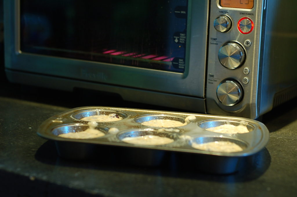 Prebaked muffins in tin by toaster