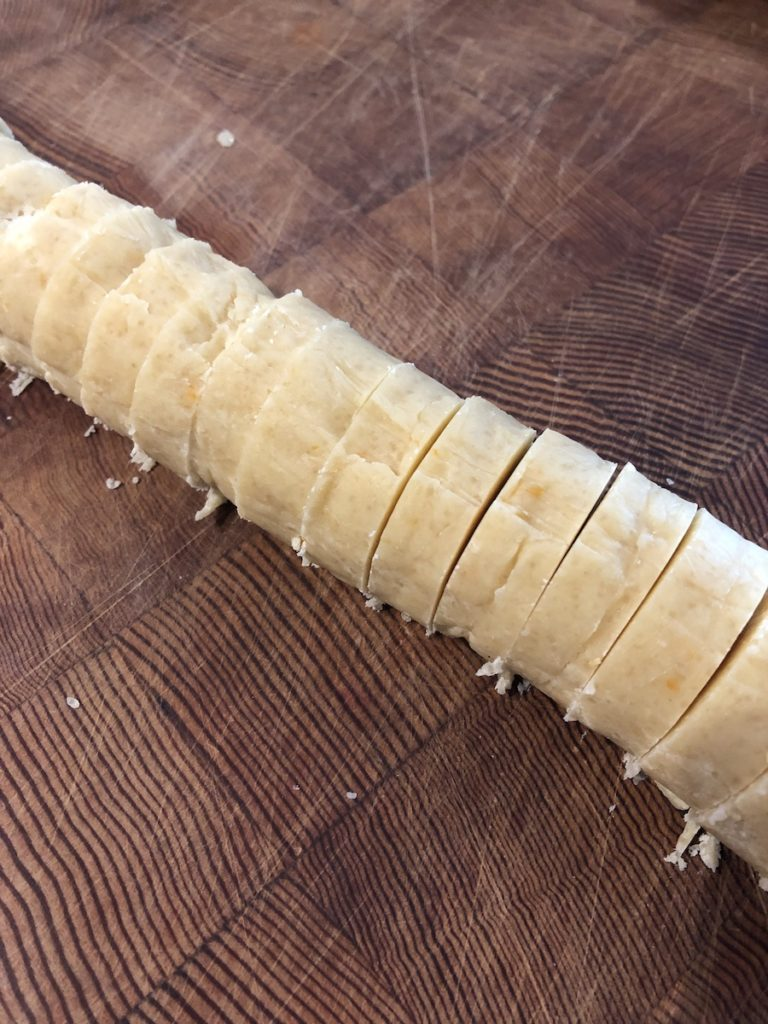 Sliced log of dough for vacation cookies.